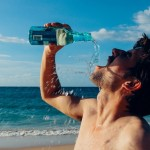 Drinking water after run on beach